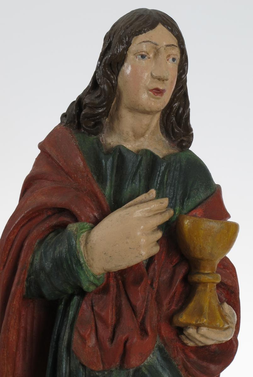 Døperen Johannes, stående mannsfigur, kalk (drikkebeger på stett), i hånden