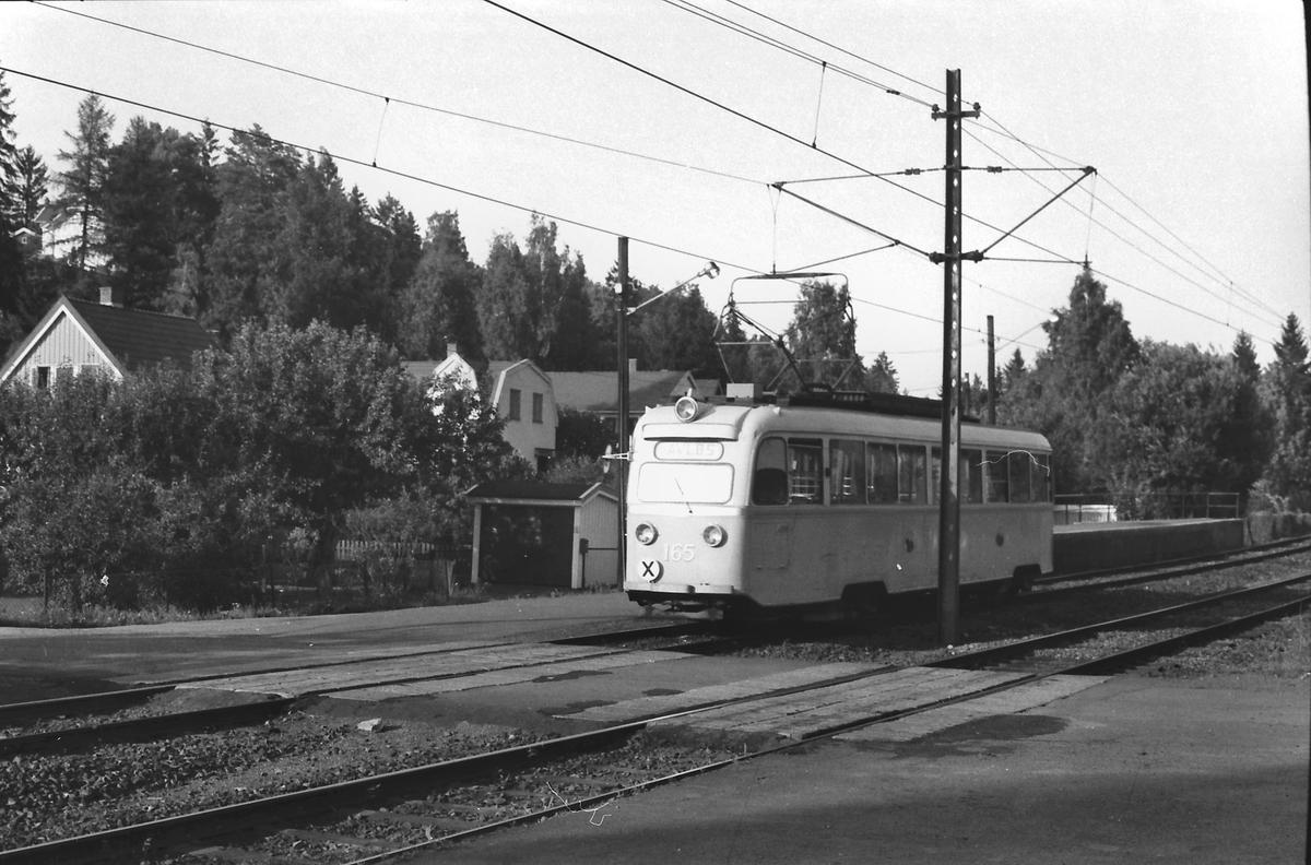 Gullfisk 165 på vei mot Avløs. Oslo Sporveier, Kolsåsbanen.