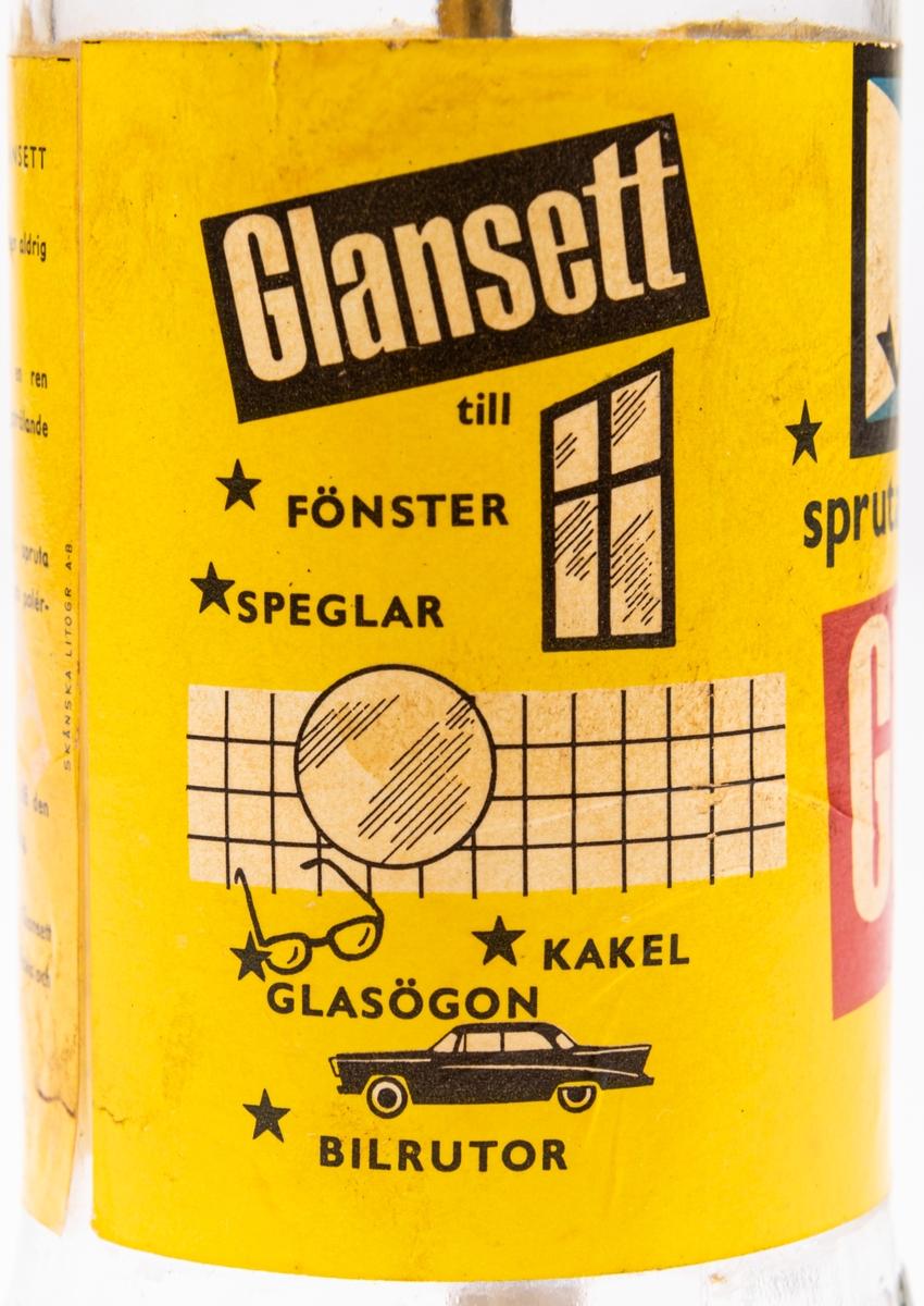 """Glasflaska med pump av metall. Gul etikett men texten """"Glansett"""". Har innehållit putsmedel till blanka ytor som glas och kakel."""