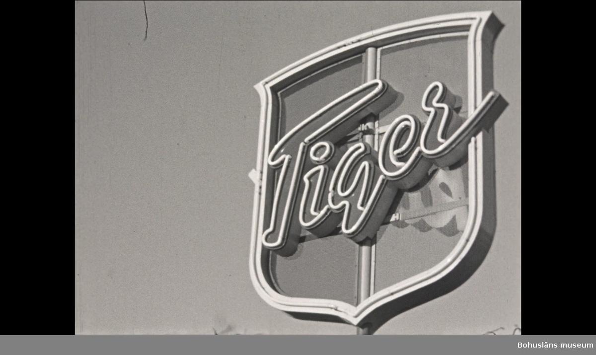 Film från konfektionsfabriken Tigers personalsammankomst i Uddevalla 1950.  0:00  Roterande skylt på Tigerfabrikens tak.  Högtidsklädda personer i samlingssal. Tal hålls från talarstolen. Flaggor och medaljer delas ut till ett flertal personer.  3:13  Middag vid långbord. 6:05 Cabaret. 9:15  Dans till levande orkester.