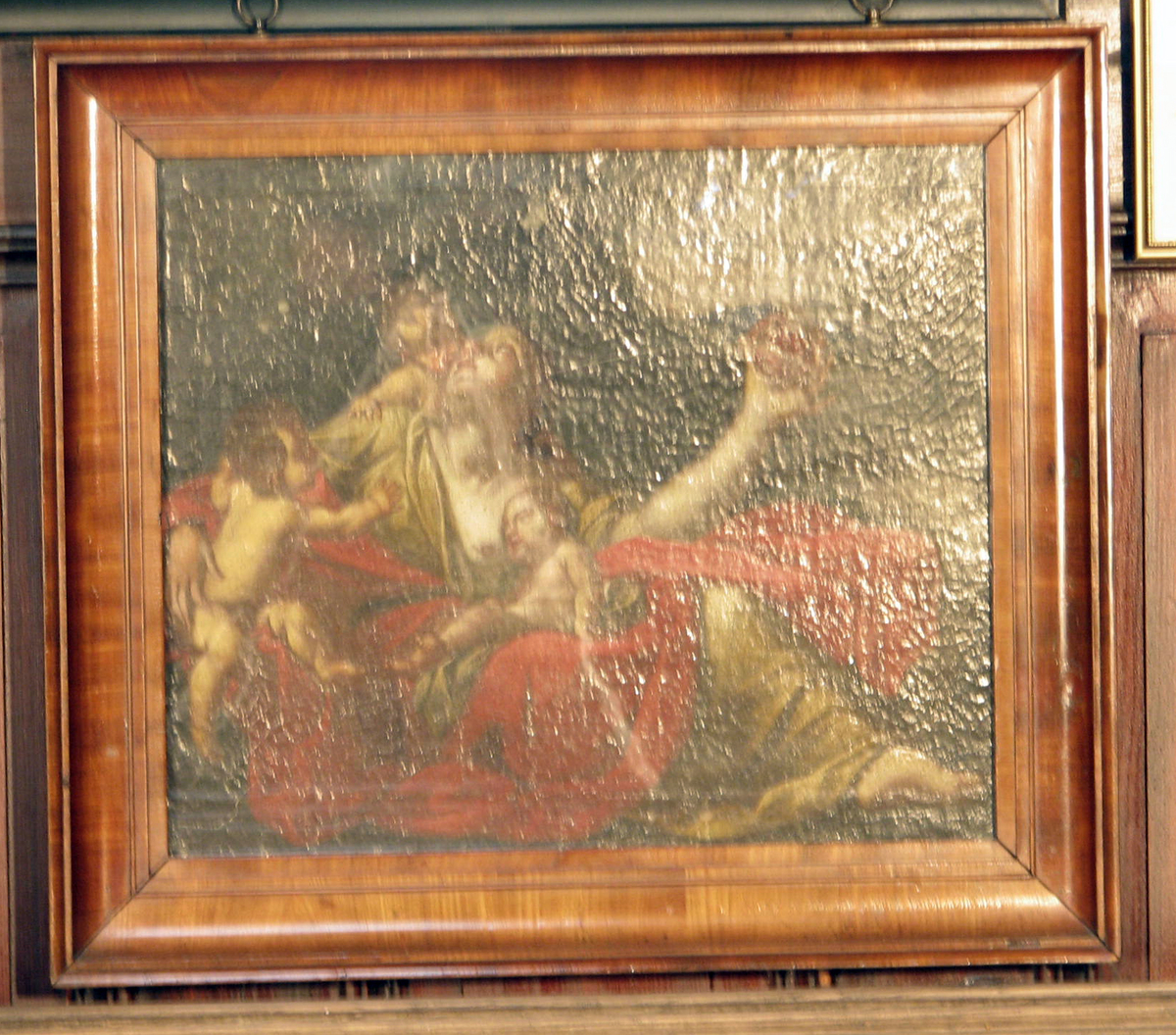 Rektangulært. Liggende kv., hodet bøyd bakover, rødt og gulbrunt draperi; 3 nakne barn omkr.; i bakgr. landskap; mørkt.