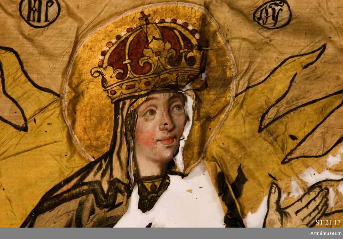 Duk av ursprungligen rött siden. I mittfältet syns Gudsmodern, Jungfru Maria, i en strålkrans stående på en månskära. Nedanför hennes fötter syns kyrkorna i Kreml, Moskva. Bård av zig-zag-mönster. I hörnen stiliserade blommor. Hela duken kantad av en mångfärgad silkefrans.