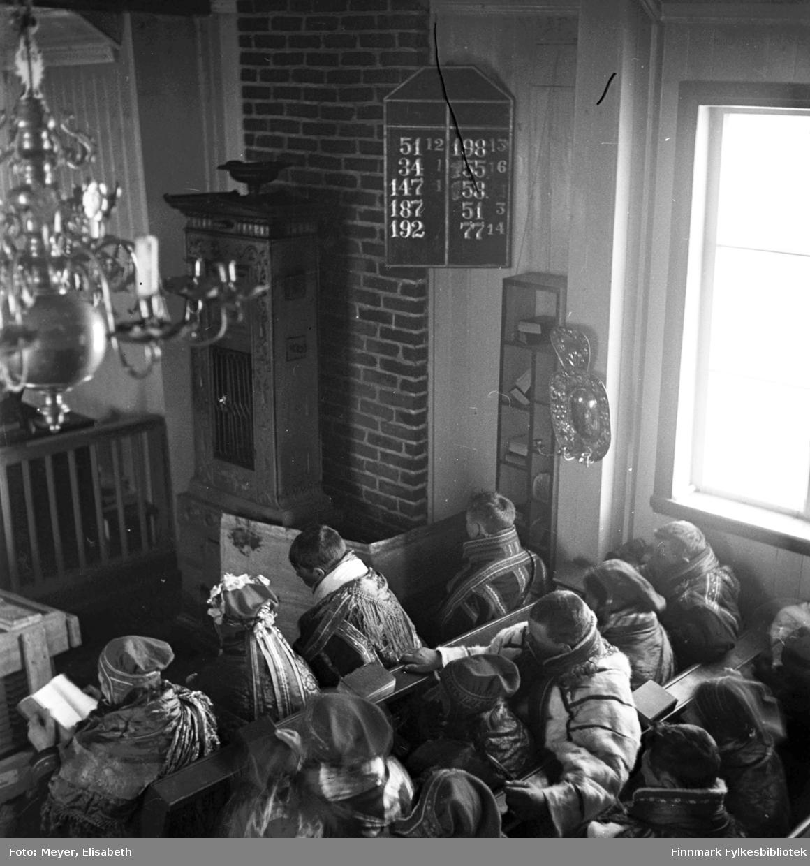 Kirkelig handling fotografert i Kautokeino kirke( 1701-1944) Bildet er påsken 1940.