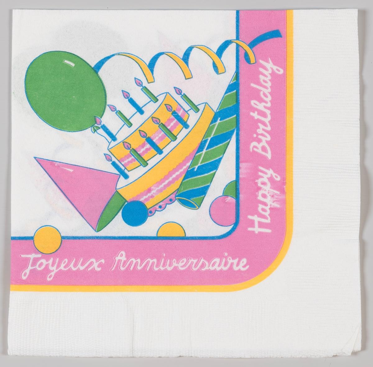 En bursdagskake, ballong, papirhatt og baller.