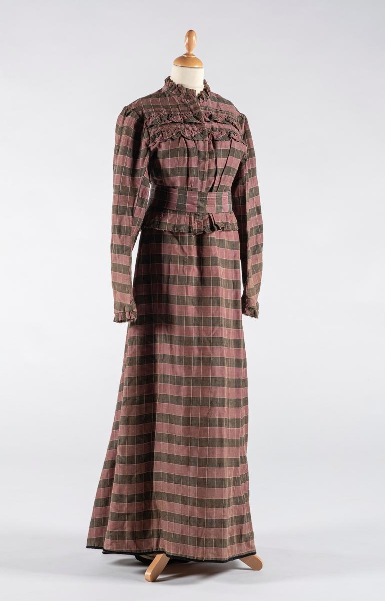 Hverdagskjole med kjoleliv, skjørt og belte. Ull og bomull blanding. Lin og bomull lerrets i ermen, ryg og skjørt. Bomullstråd.