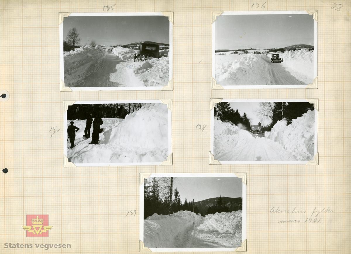"""Tekst bakpå bildet: Fra """"Minnemoen."""" Riksveien (Trondhjemsveien). Efter snestorm 12-14 mars 1931.  Fig. 2, 3, 5. Trondhjemsveien i Eidsvolll etter snestorm 12-14 mars 1931. Jf.  """"Meddelelser fra Veidirektøren Nr. 10- og Nr. 11-1931: """"Snerydningen på våre veier vinteren 1930-1931"""". Se Nr.1-1932 side 11. (forts. fra Nr. 11-1931 s.171) Akershus fylke.   Bilde 2) Helside i album """"Snebrøyting og sneskjermer.""""  Se vedlegg i Nedlastinger lenger ned på siden.  Ref. til """"Meddelelser fra Veidirektøren"""", Nr. 3-1930,  """"Snebrøytingsforsøk med 6-hjulere,"""" av overingeniør N. Saxegaard."""