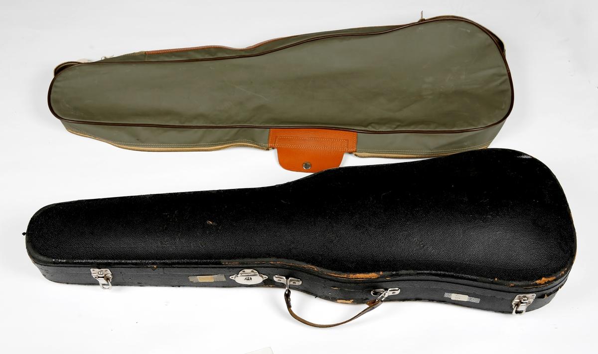 """""""a:Fiolin i tre. Gripebrett, skruer, strengfeste og hakebrett i ibenholt. L 60 B 20.5 H 3.5. b:Fiolinbue i tre med handtak i perlemor-innlagt ibenholt og surring med svart tråd.Hvite buehår. L 74 B 3 . c:Fiolinkasse i presset papp med svart dekke, innvendig grønn filt, bærehempe og metallås. L 77 B 20.5 H 9 . d:Grått lerretstrekk m/plastoverflate,glidelås,kunstlærforster- king. e:Kolofonium. f: et lommetørkle, hvitt.""""""""       """""""