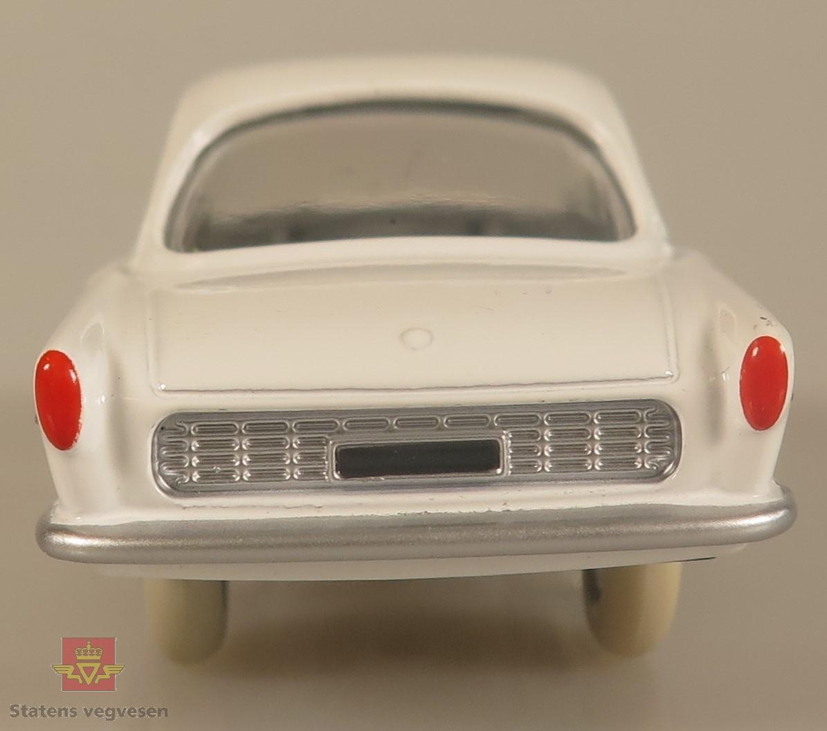 Modellbil av en Renault Floride, modellbilen er hvit farget med hvite dekk.