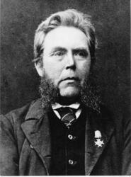 Bröstbild av guldsmeden Carl Edvard Fong, med medalj på brös