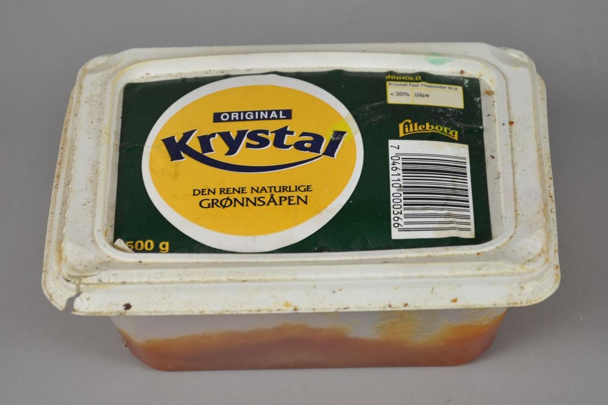 Rektangulær boks av plast, med grønnsåpe.