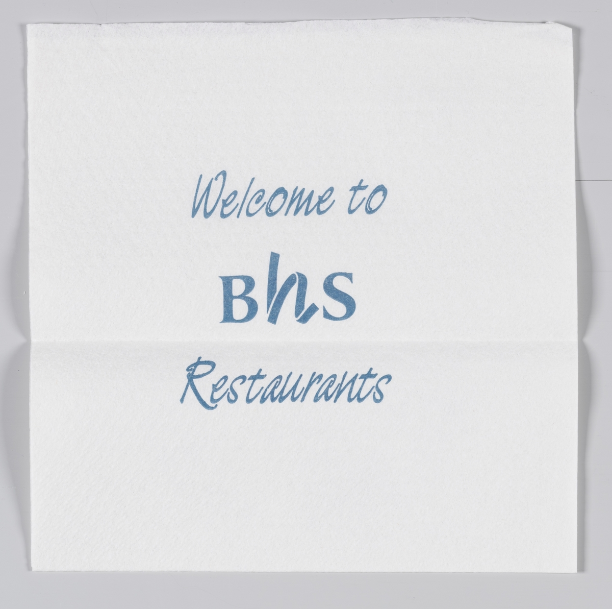 En tegning av grøntsaker, frukt og korn og en reklametekst for BHS restauranter.