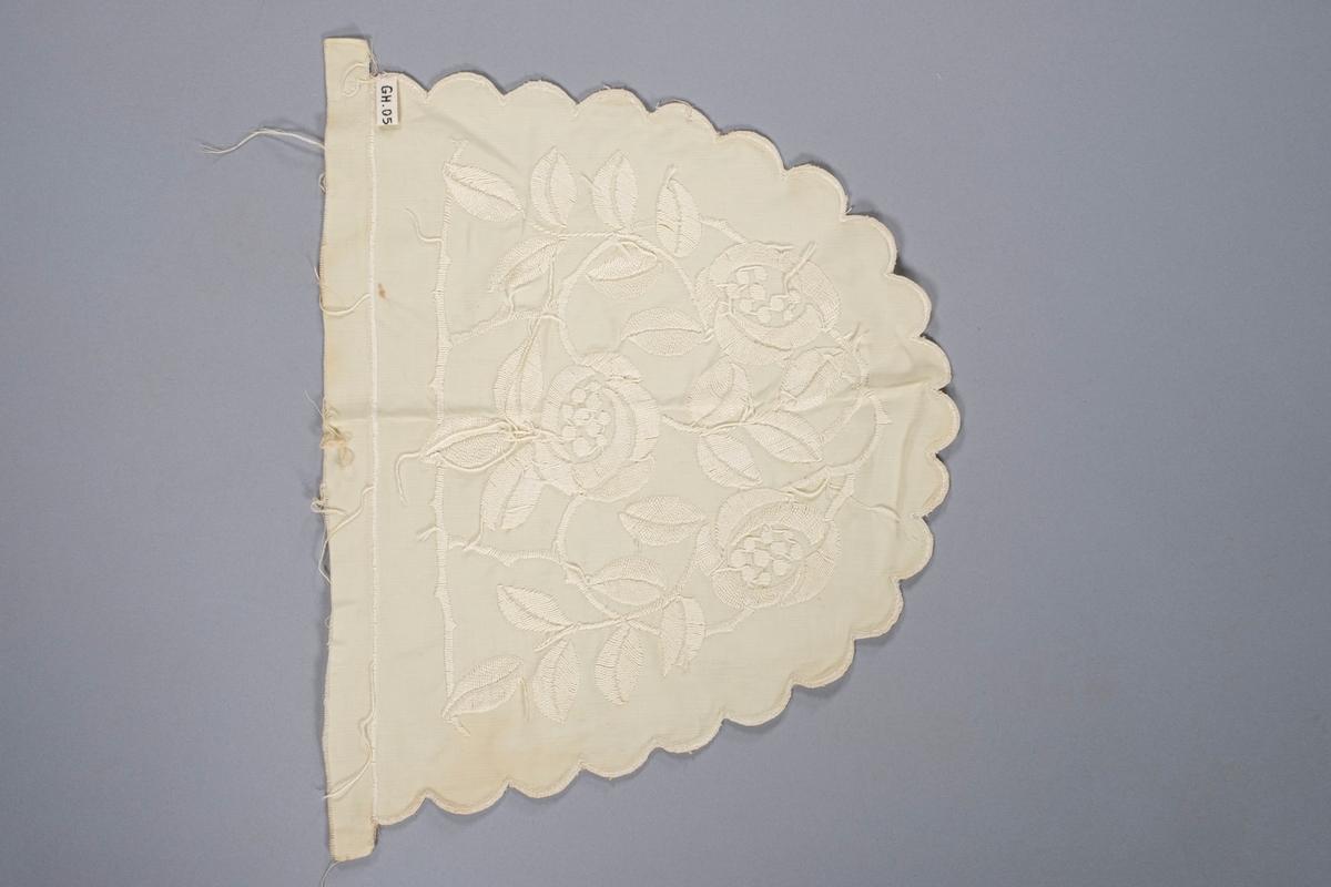 Tevarmer, 1 av 2 deler. Den er brodert med jugendinspirerert blomstermønster.
