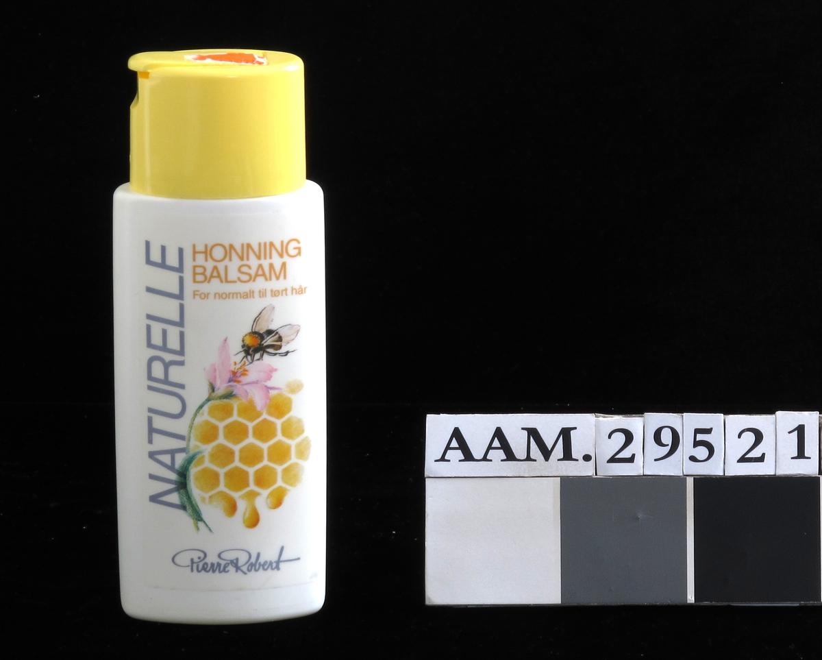 Plastfalske for hårbalsam. Beige flaske, gul kork. med klikklukning.